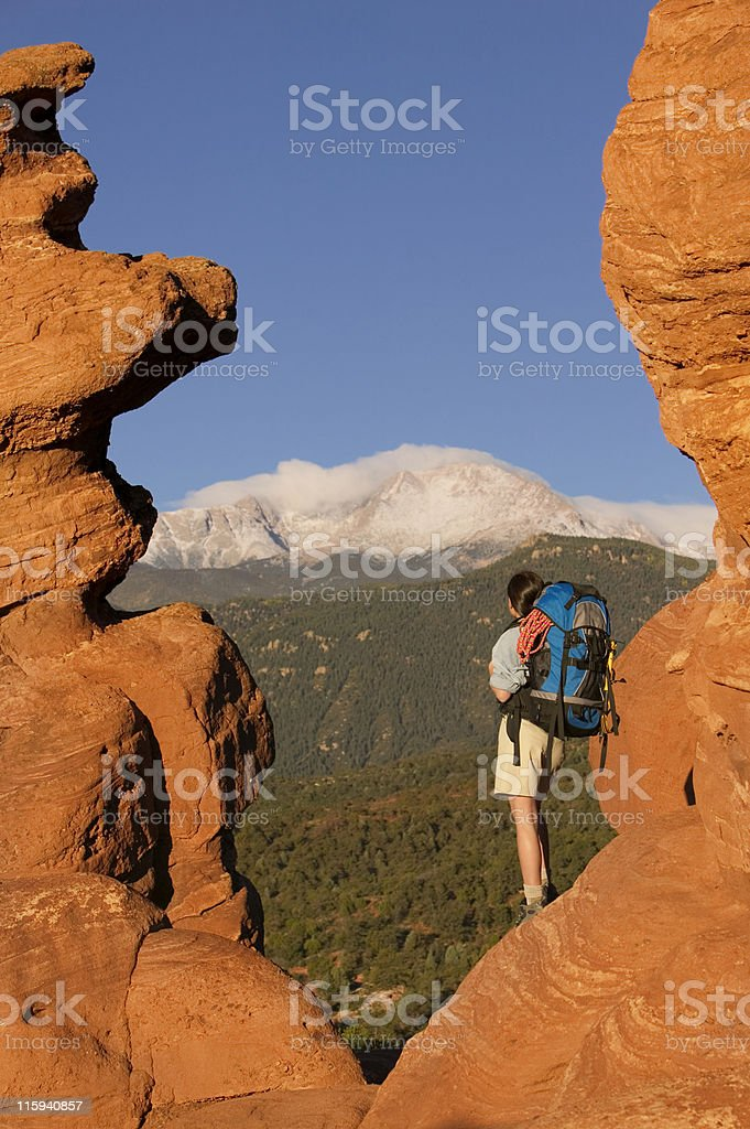 Female Backpacker Looking at Pike's Peak stock photo