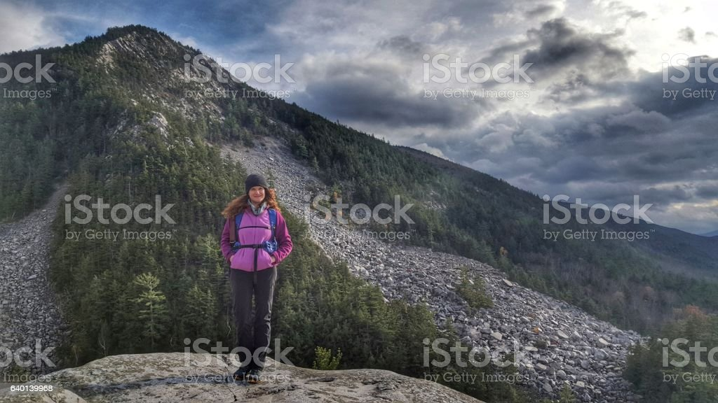 Female Backpacker, Vermont White Rock Ice Beds Hike, Rock Slide stock photo