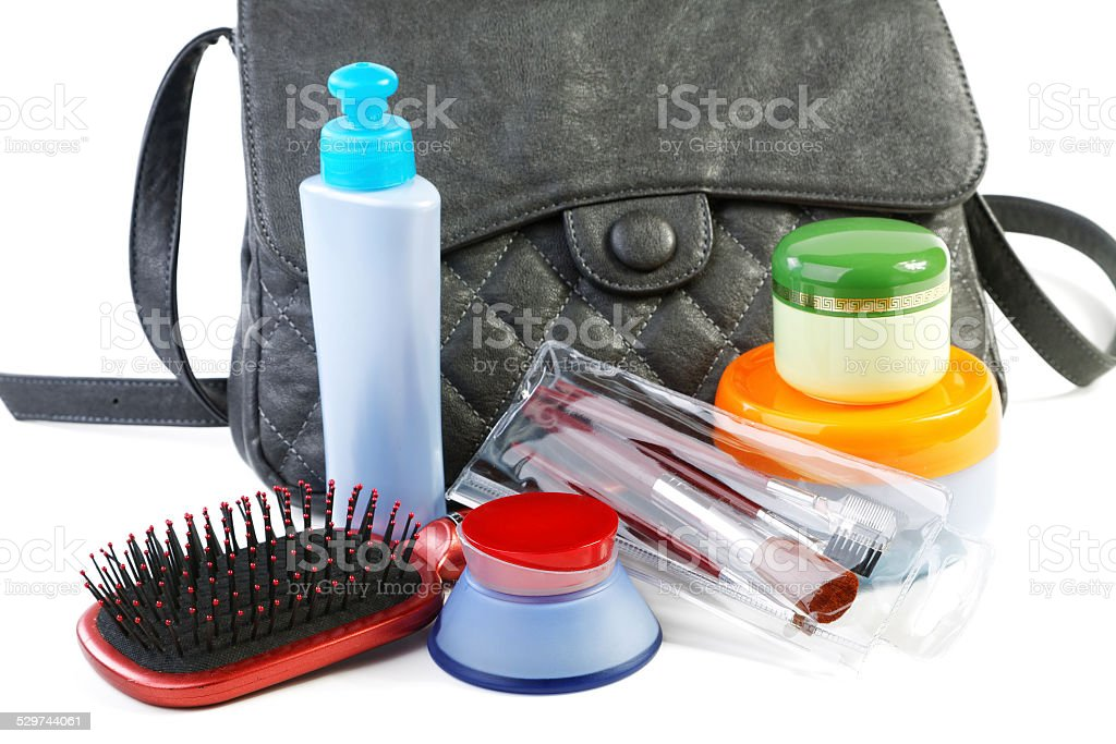 Female bag and cosmetics isolated on a white background stock photo