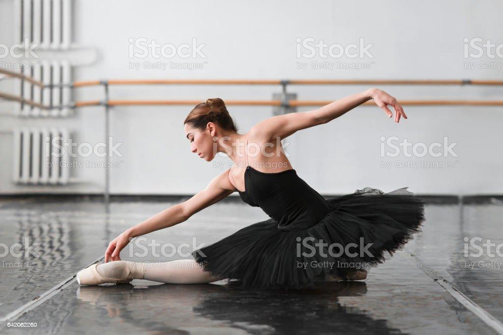 Female ballet dancer posin on rehearsal stock photo