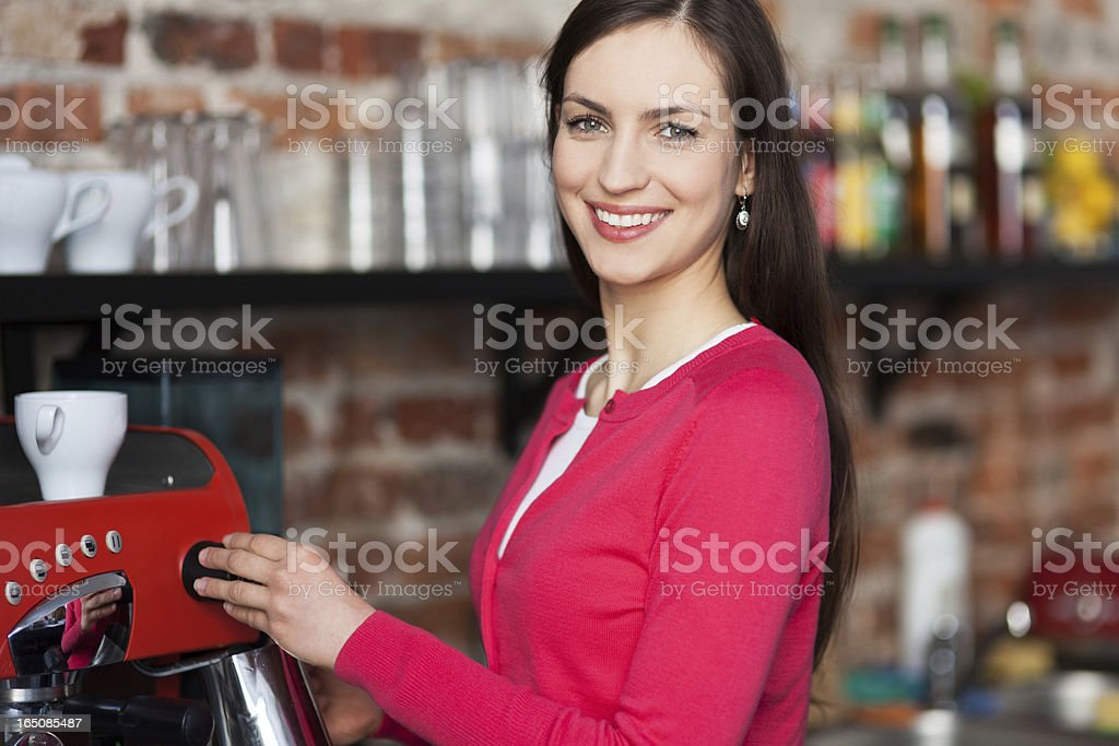 Female barista making coffee royalty-free stock photo