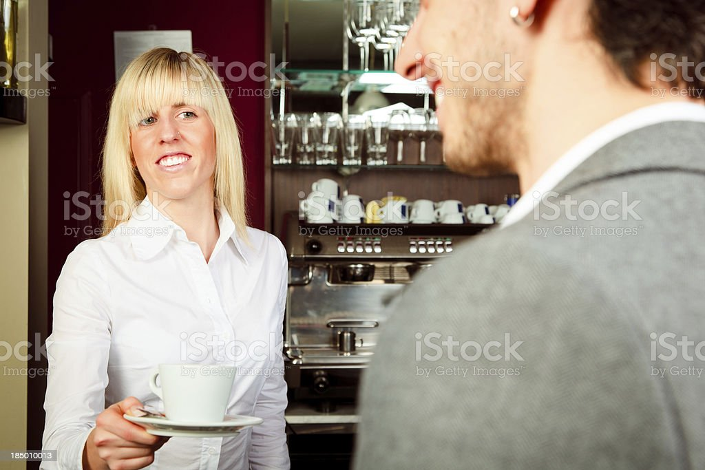 female bartende serving coffee royalty-free stock photo