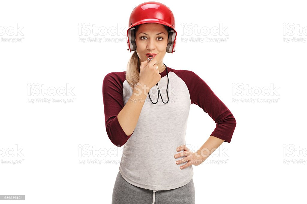 Female baseball coach blowing a whistle stock photo