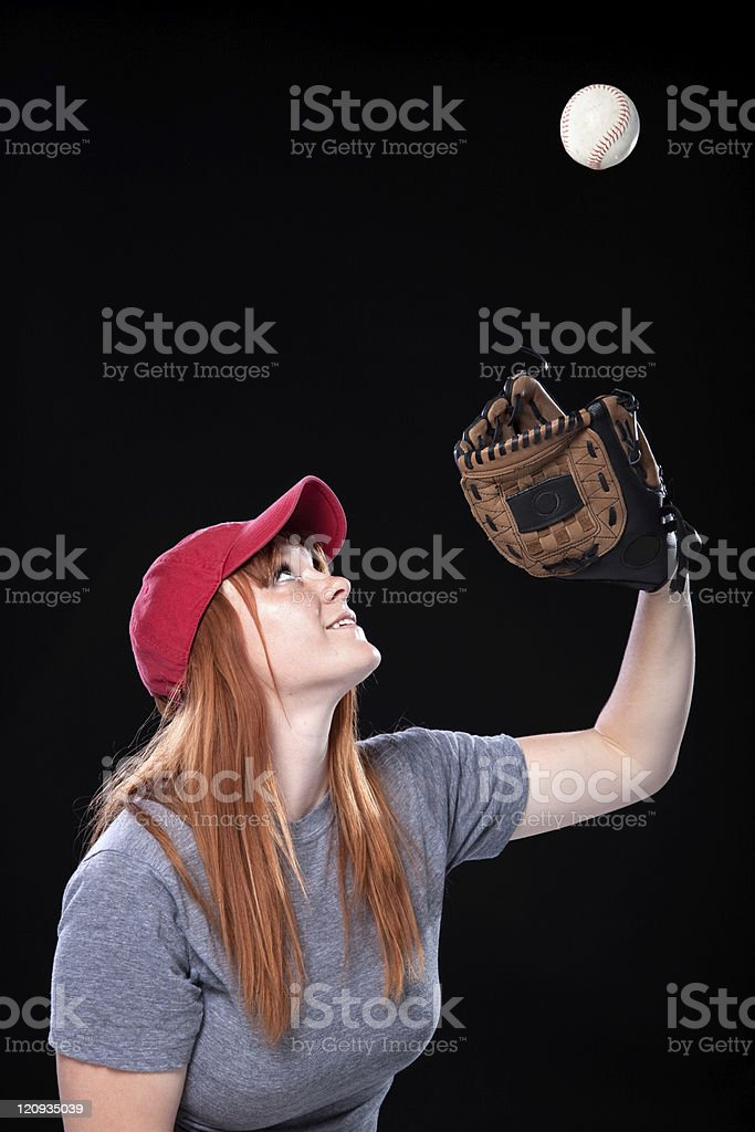 Female Baseball Player with Cap and Mitt Catching Ball royalty-free stock photo
