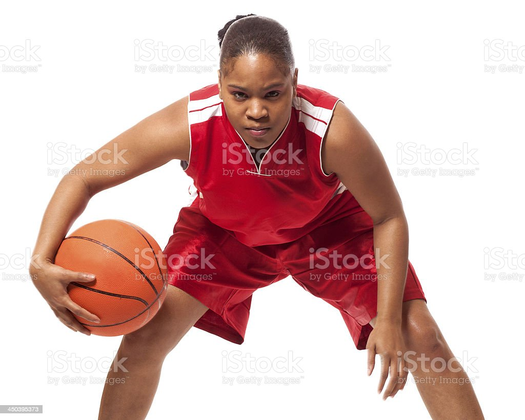Female basketball player in red isolated on white stock photo