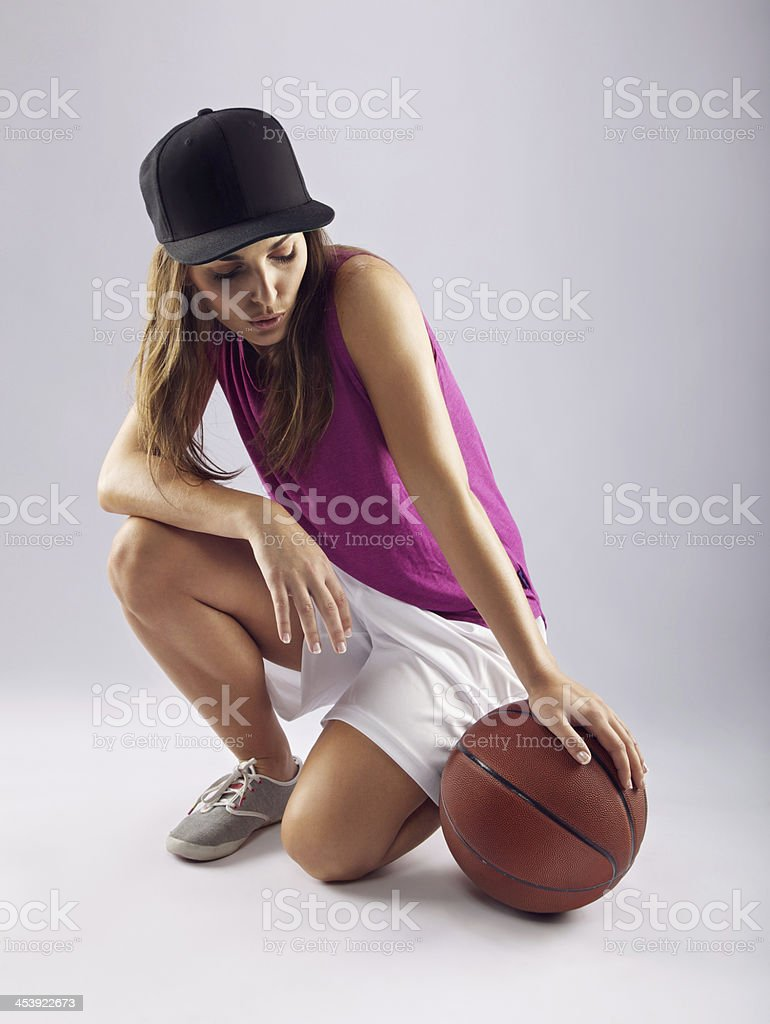 Female basketball player with ball stock photo