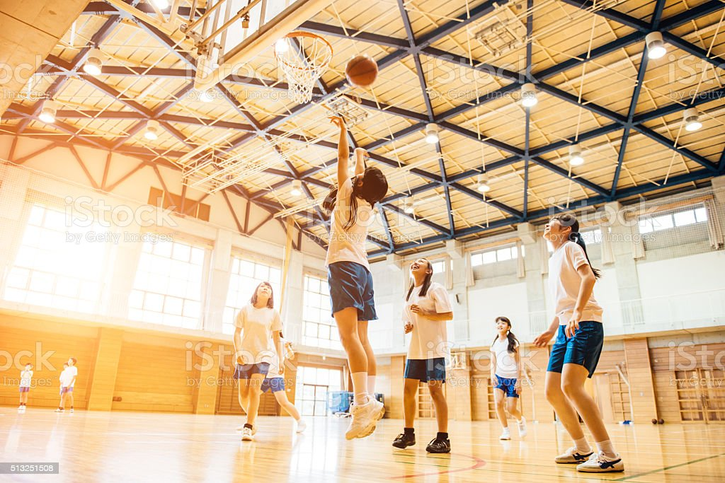 Female Basketball Team Playing in Japanese High School stock photo