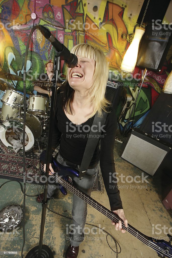Female bass player screaming royalty-free stock photo