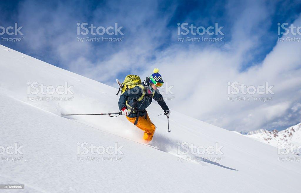 female beautiful skier wearing winter hat stock photo