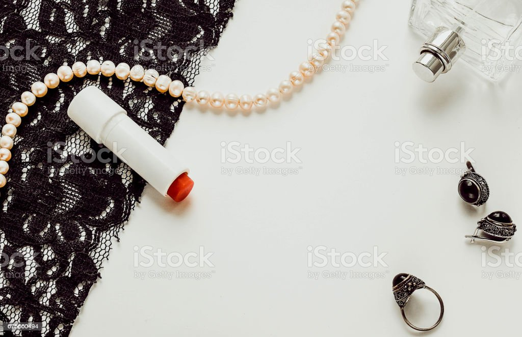 Female beauty accessories, perfume, jewelry and lipstick stock photo