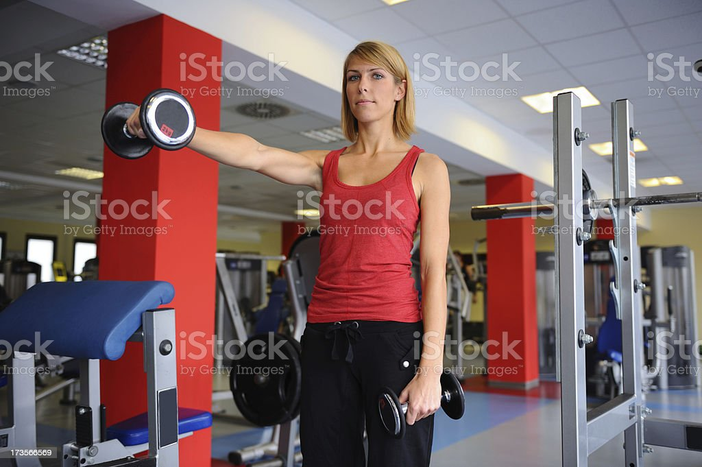 Female beauty at weight training royalty-free stock photo