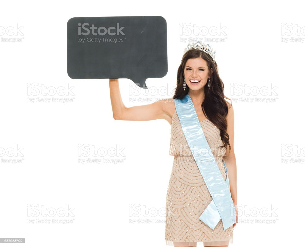 Female beauty queen holding speech bubble stock photo