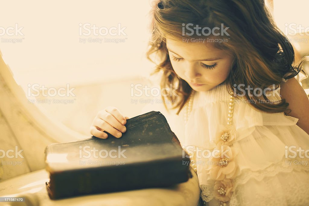 female beauty vintage Bible little girl stock photo