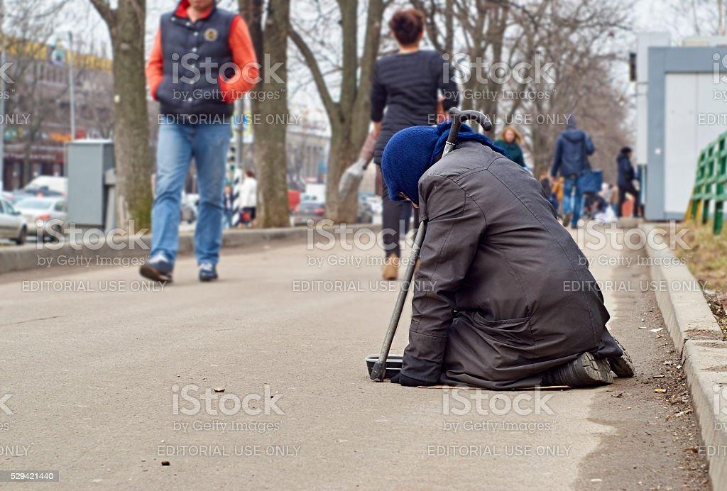 Female beggar asks for money stock photo