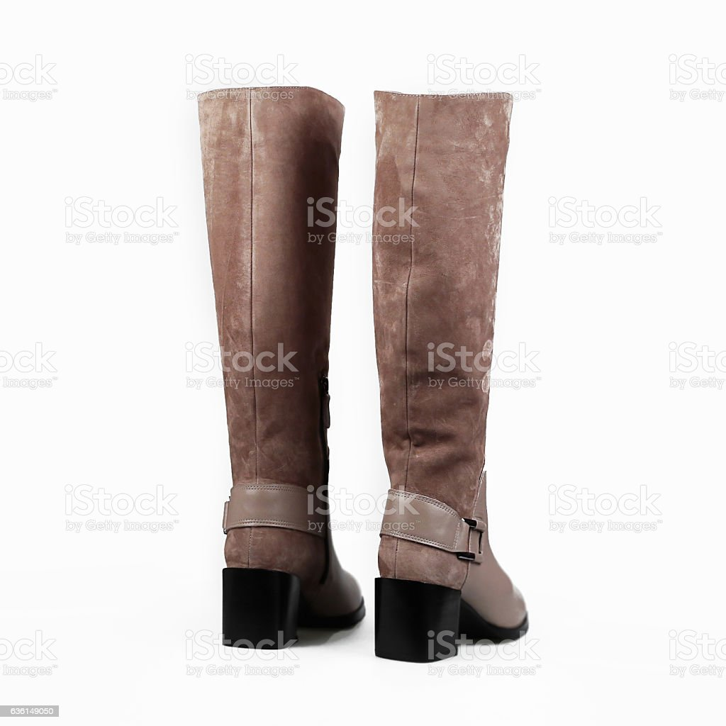 female beige boots over white stock photo