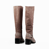female beige boots over white