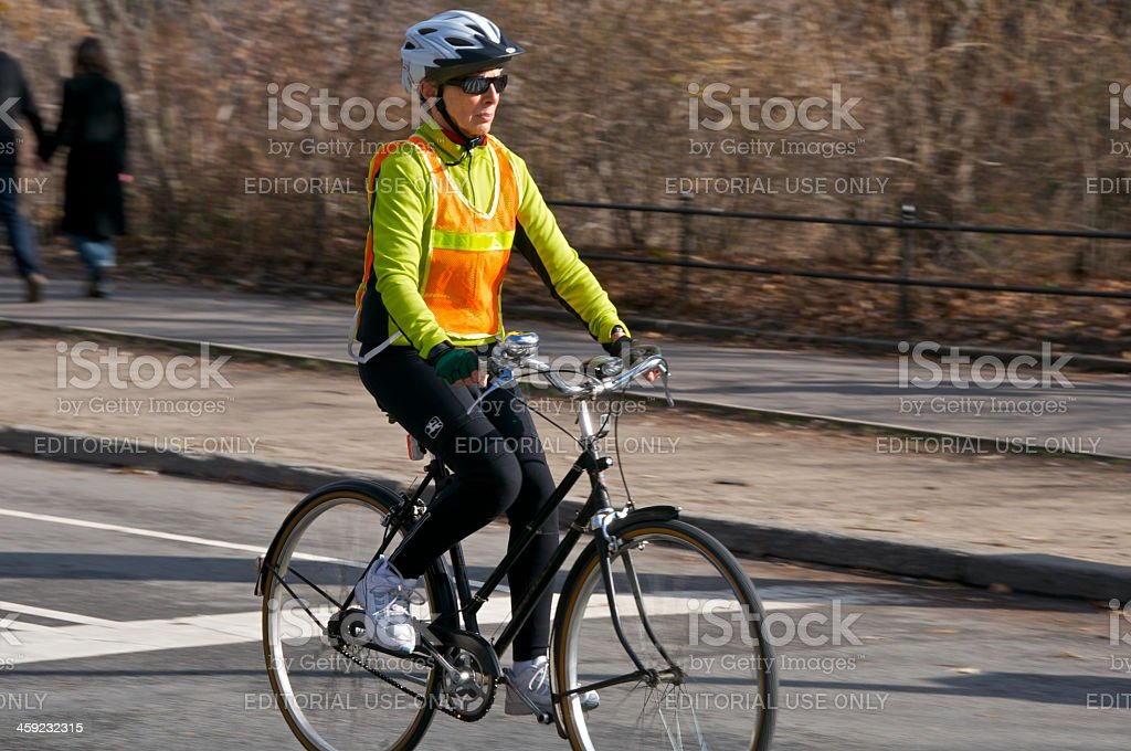 Female bicycling Central Park, Manhattan, New York City stock photo