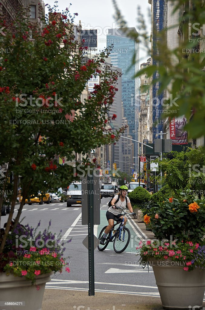 'Female Bicyclist on turn at E.25th St, Manhattan, NYC' stock photo