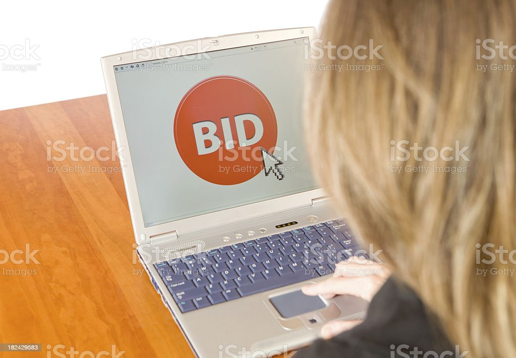 Female Bidding on an Online Auction stock photo