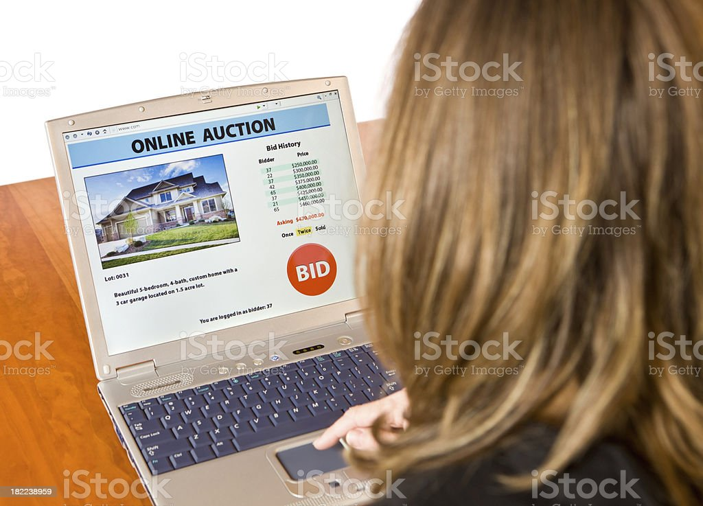 Female Bidding on an Online Real Estate Auction royalty-free stock photo