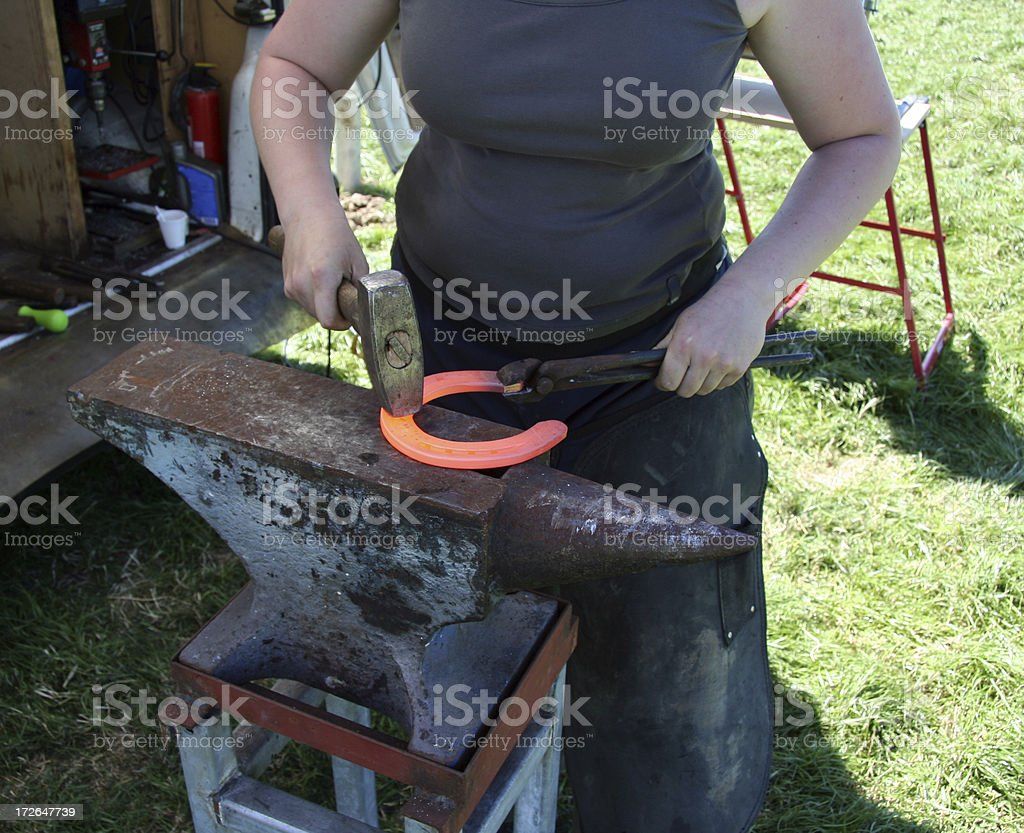 female blacksmith stock photo