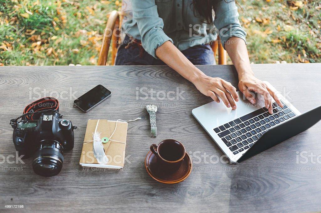 Female blogger writing on the laptop stock photo