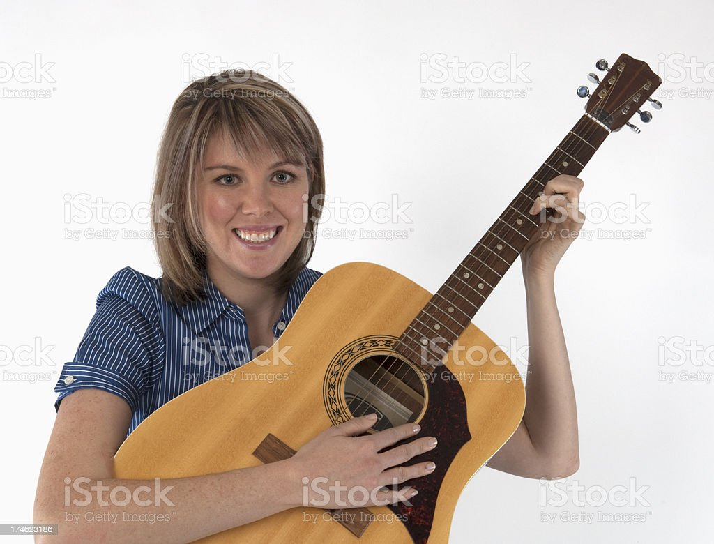 Female blonde with guitar - 1 stock photo