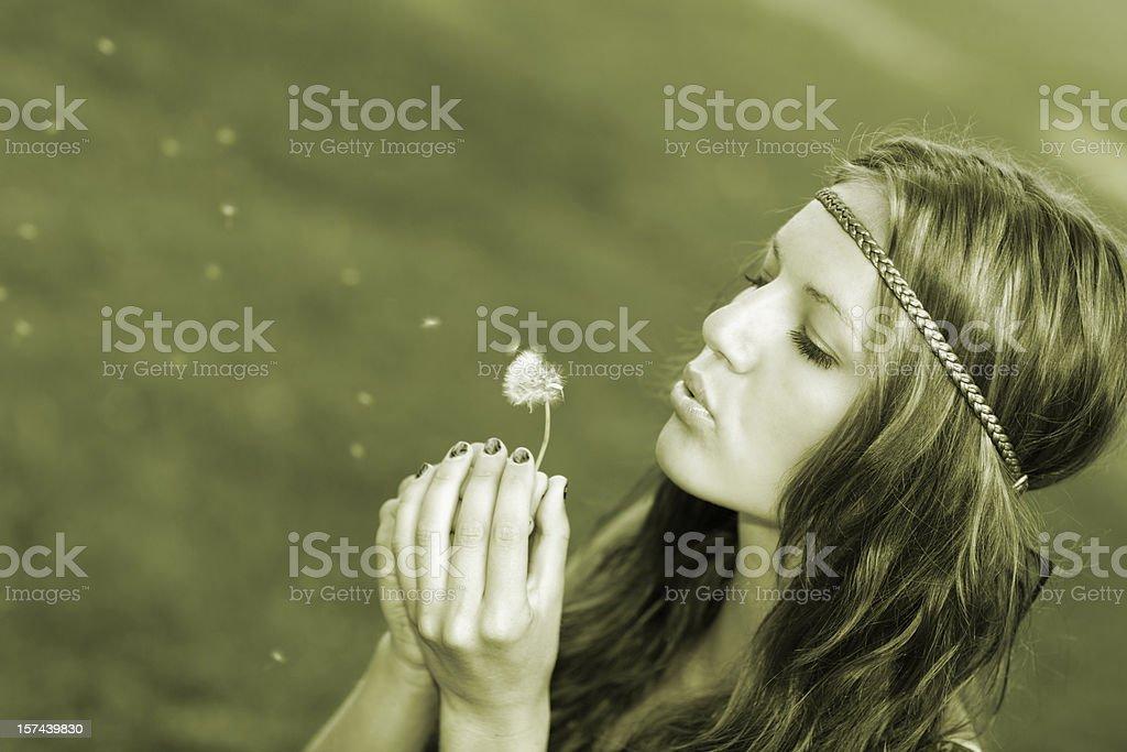 Female Blowing Dandelion royalty-free stock photo