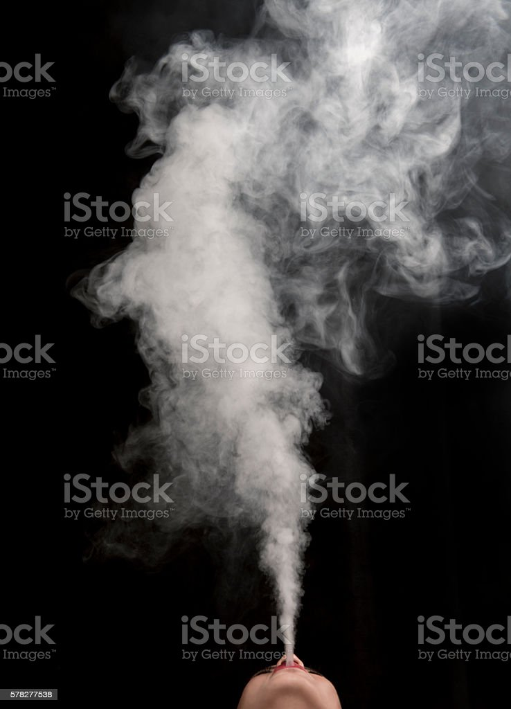 Female blowing vape smoke vapor stock photo