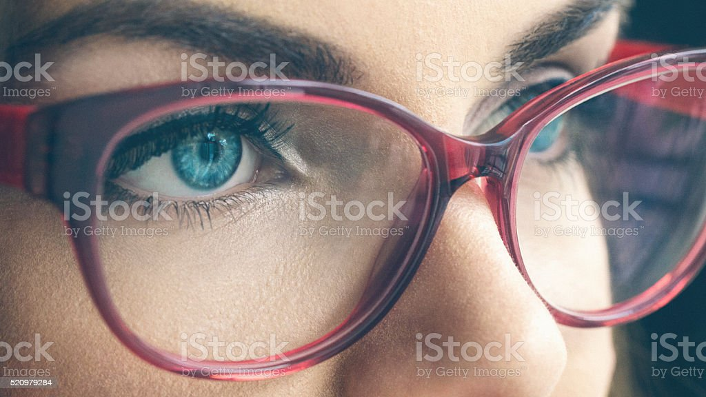 Female blue eyes macro shot stock photo