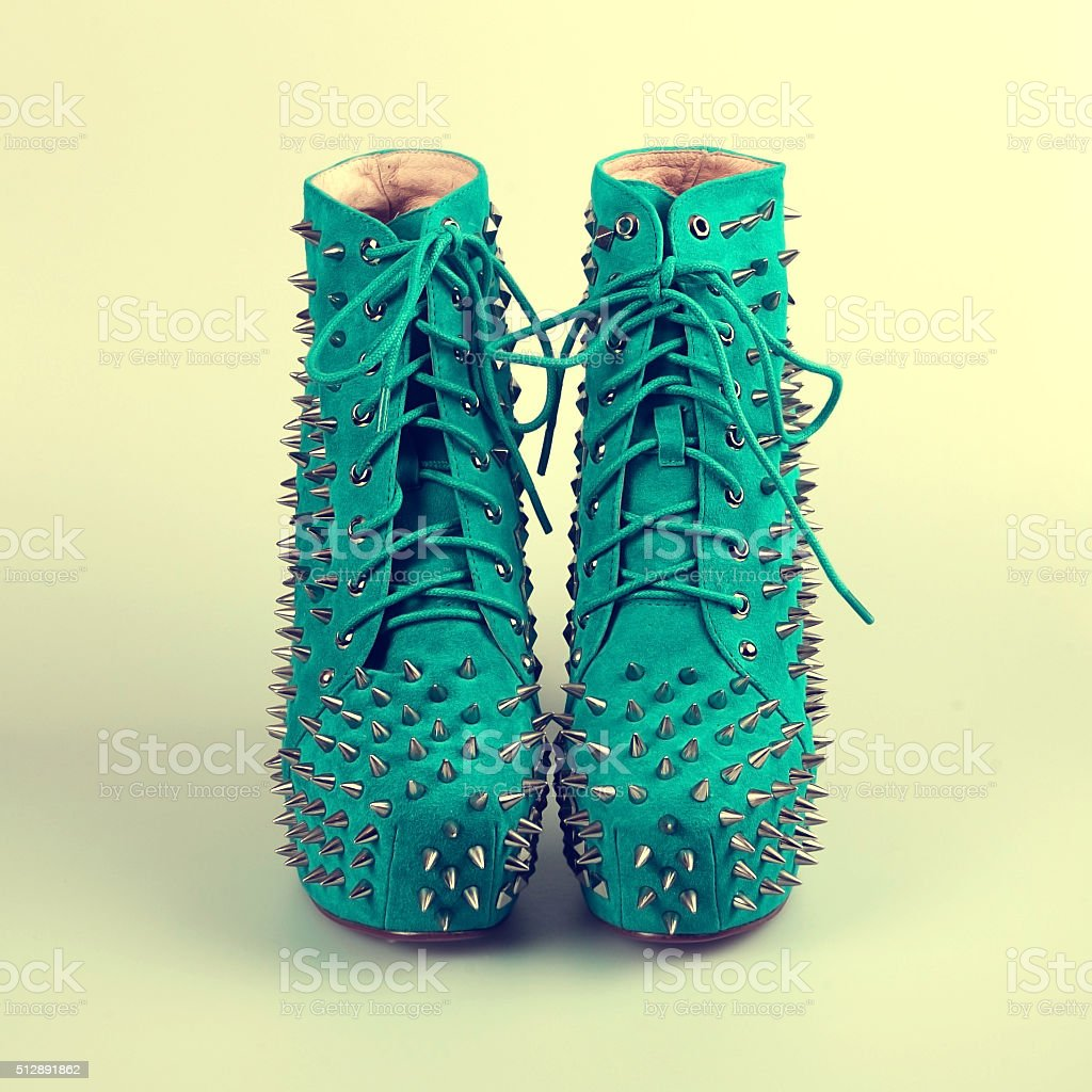 female blue shoes with spikes stock photo