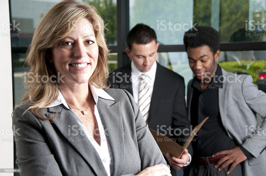 Female Boss and her Employees royalty-free stock photo