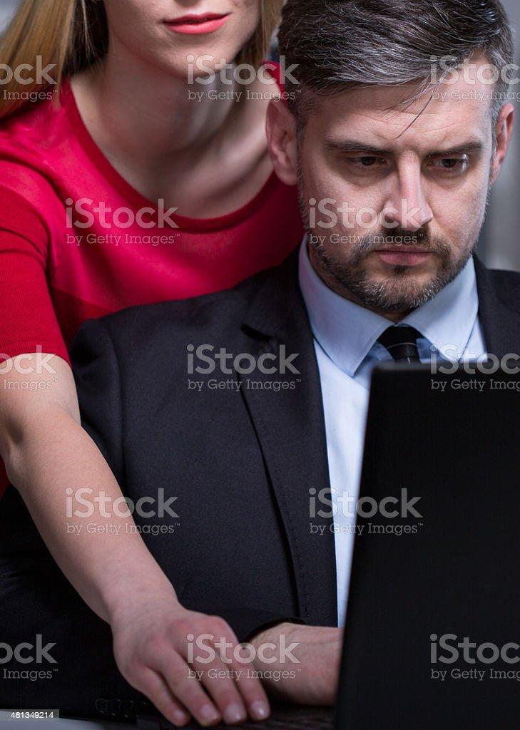 Female boss harassing her employee stock photo