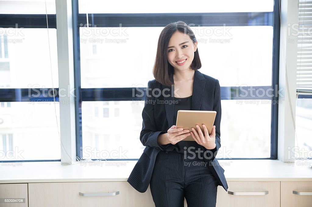 female boss tablet stock photo