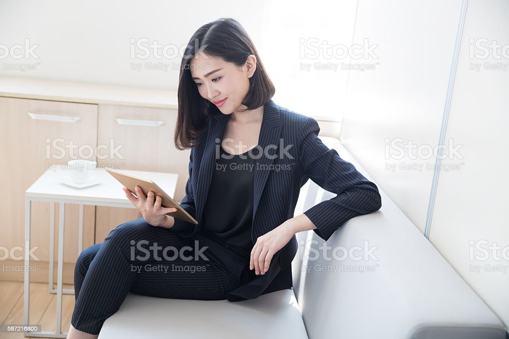 female boss tablet stock photo