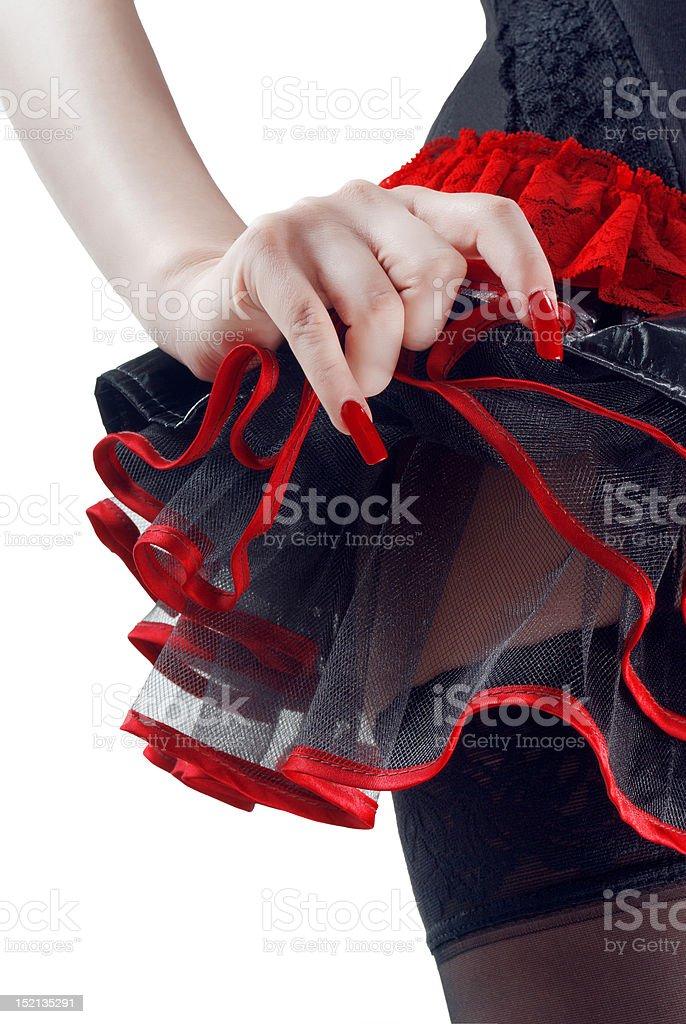 Hembra bottoms en PVC negro y rojo aislado de falda foto de stock libre de derechos