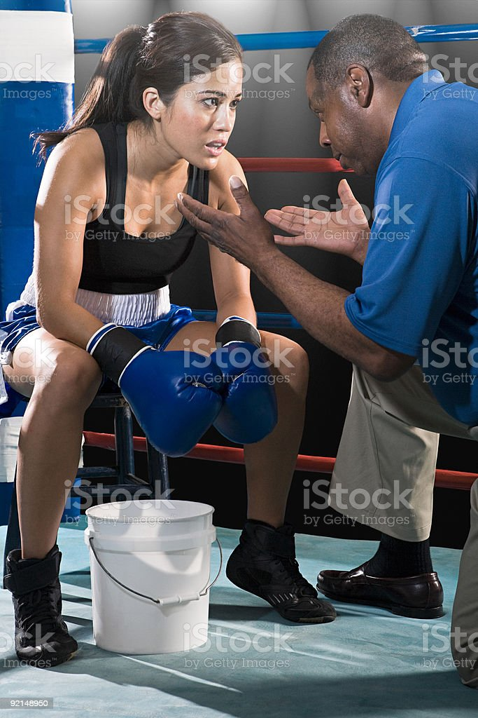 Female boxer and coach stock photo