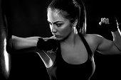 Female boxer at traning.
