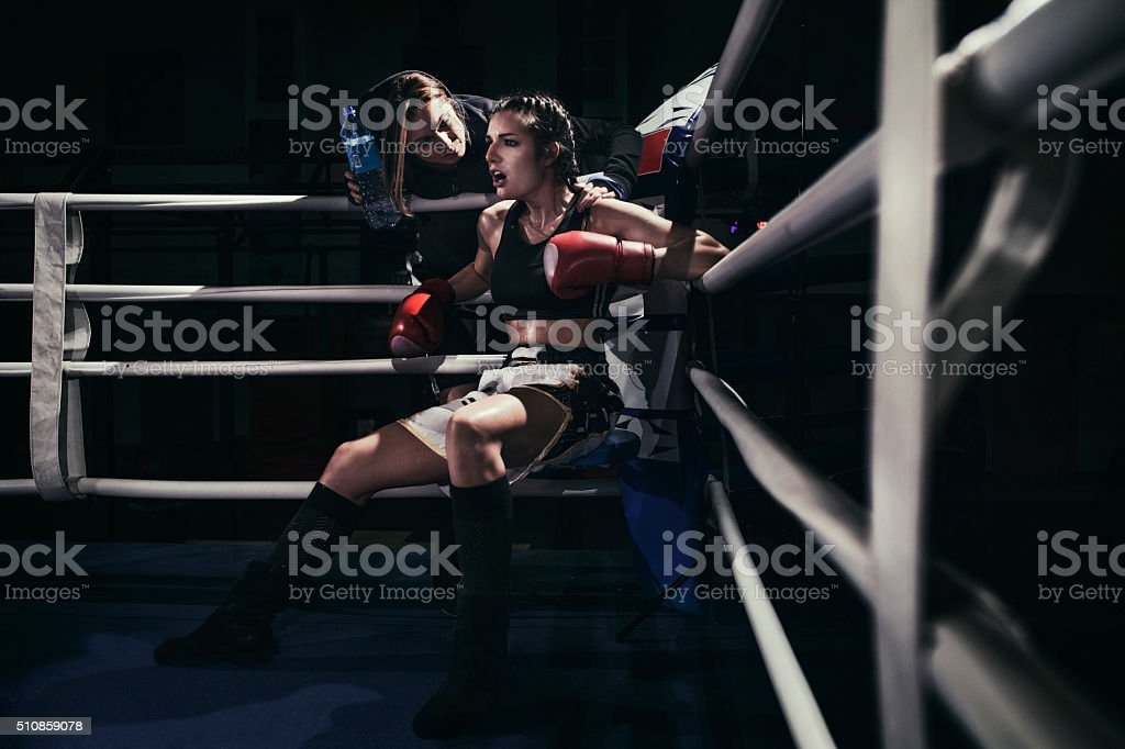 Female boxer in a boxing ring stock photo
