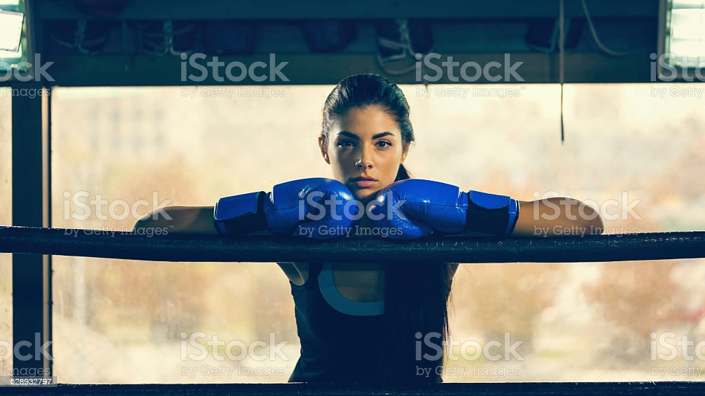 Female Boxer In Boxing Ring stock photo
