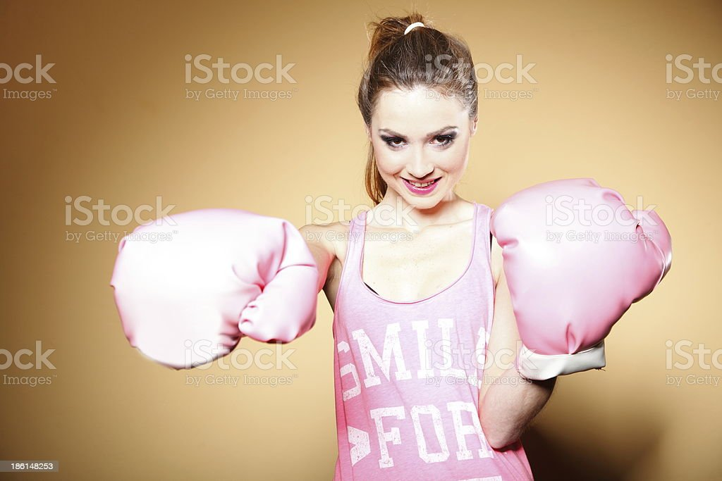 Female boxer model with big fun pink gloves royalty-free stock photo