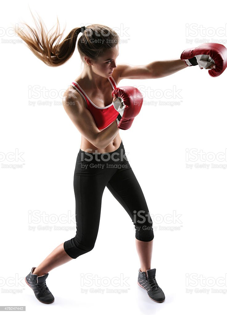 Female boxer punching wearing boxing gloves stock photo