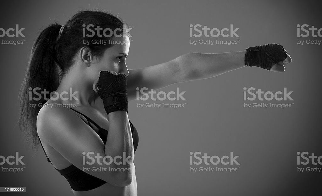 Female boxer throwing a punch stock photo
