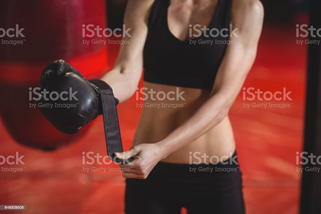 Female boxer wearing boxing gloves stock photo