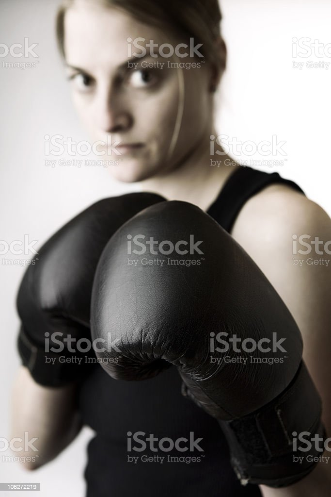 Female Boxer with Black Boxing Gloves royalty-free stock photo