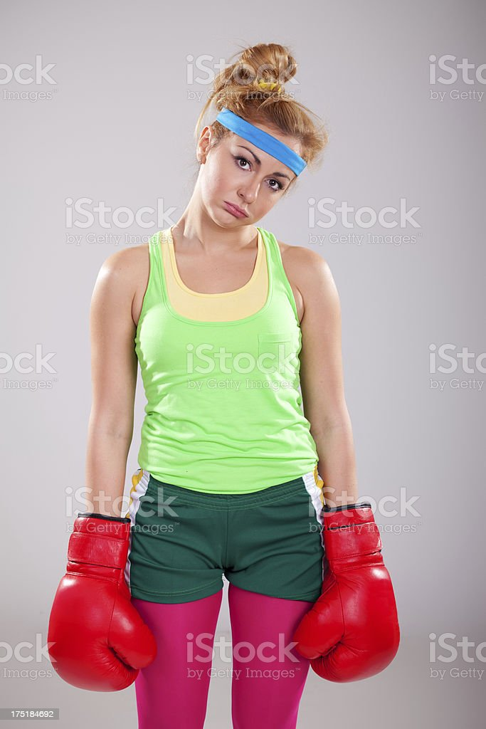Female boxer with boxing gloves makind sad face royalty-free stock photo