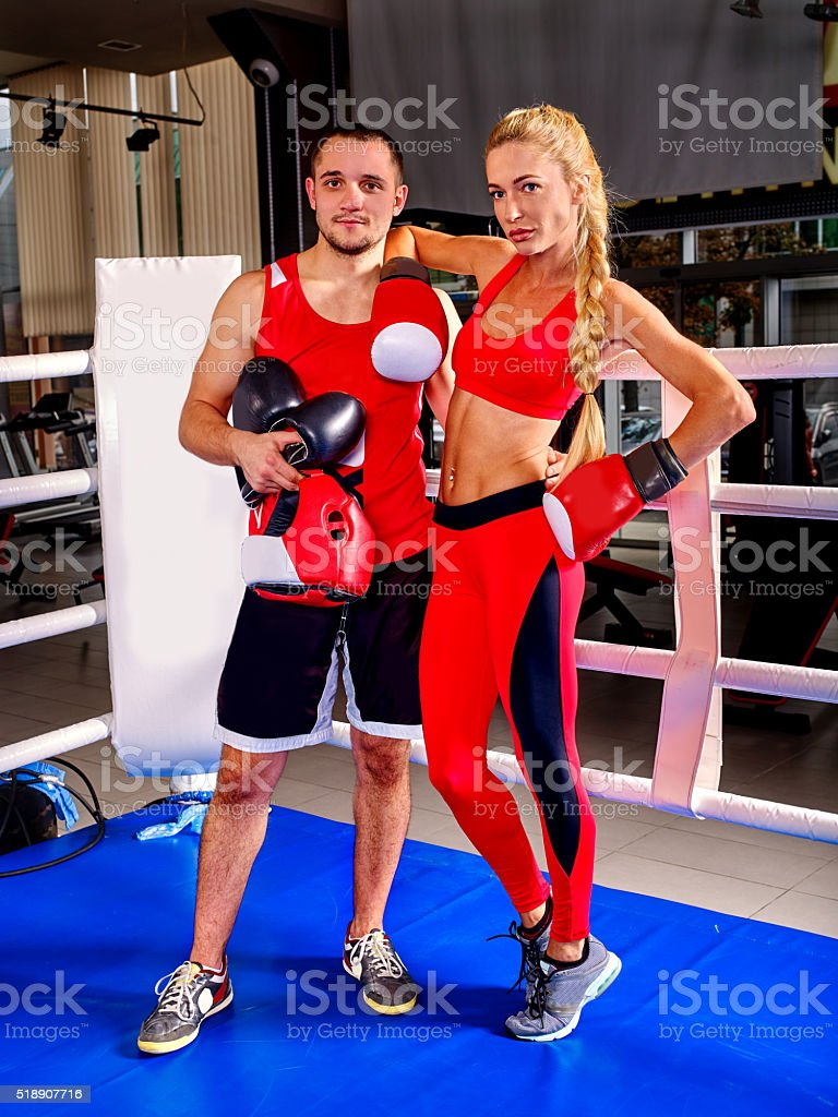 Female boxer with your male coach after workout stock photo