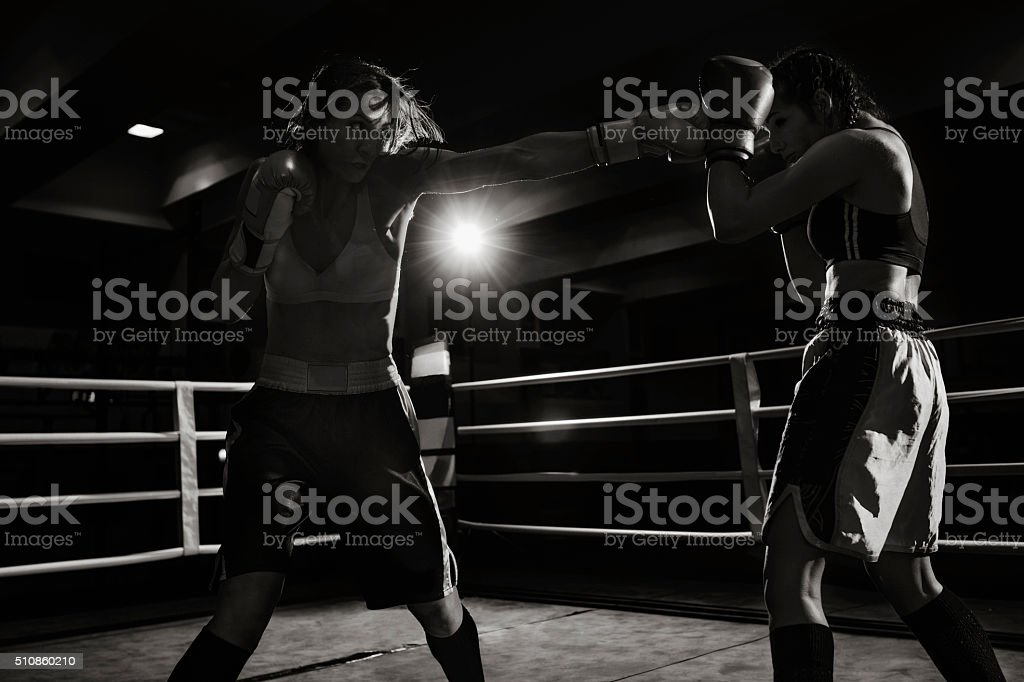 Female boxers fighting in a boxing ring stock photo
