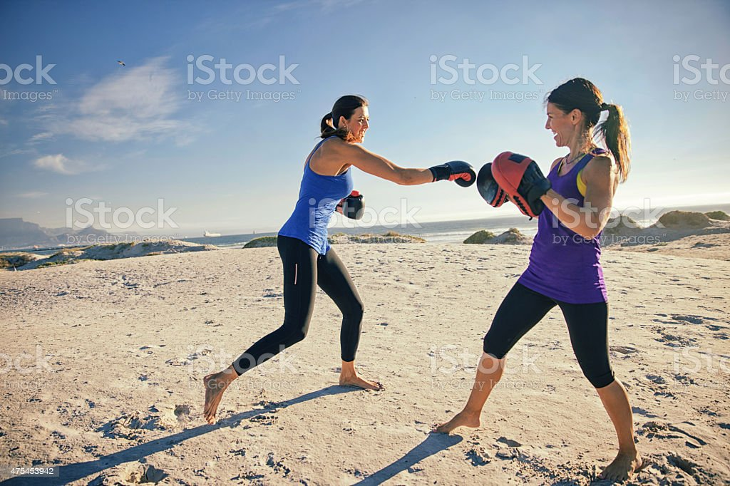 Female boxing practicing outdoors stock photo