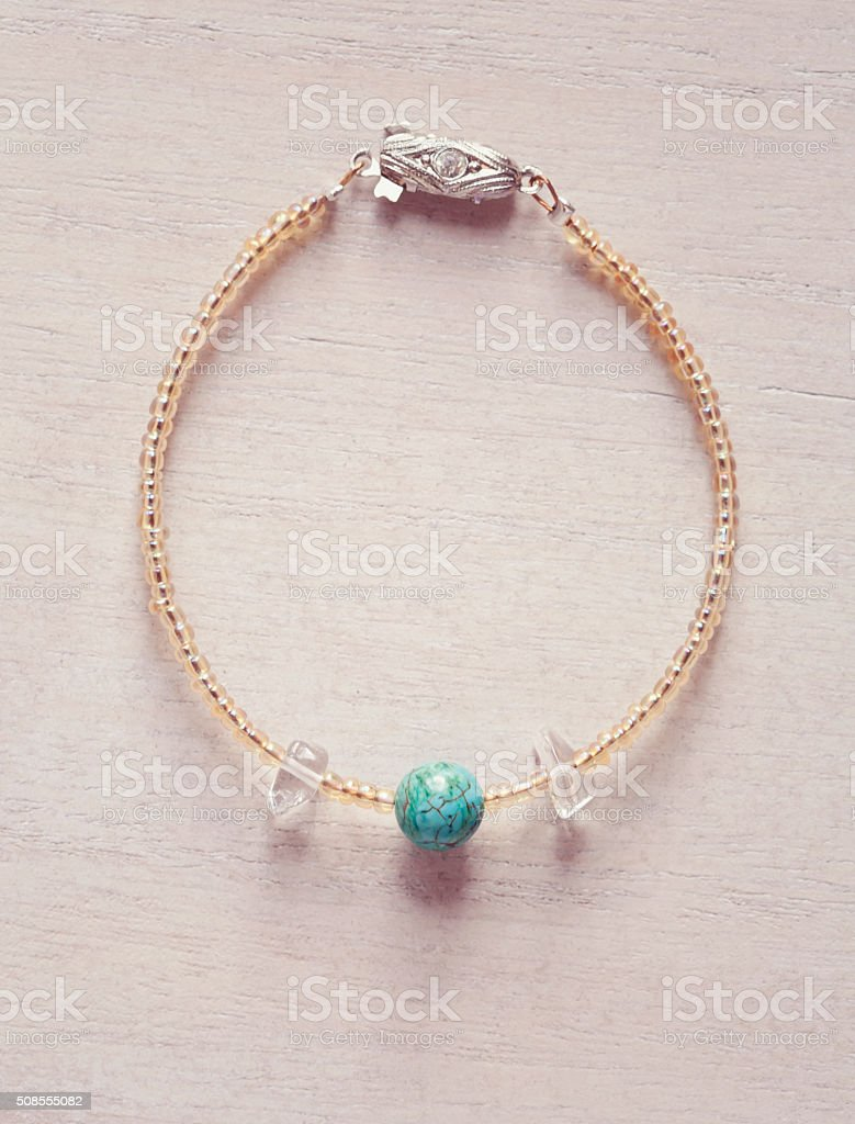 female bracelet with natural turquise and crystal quartz stock photo